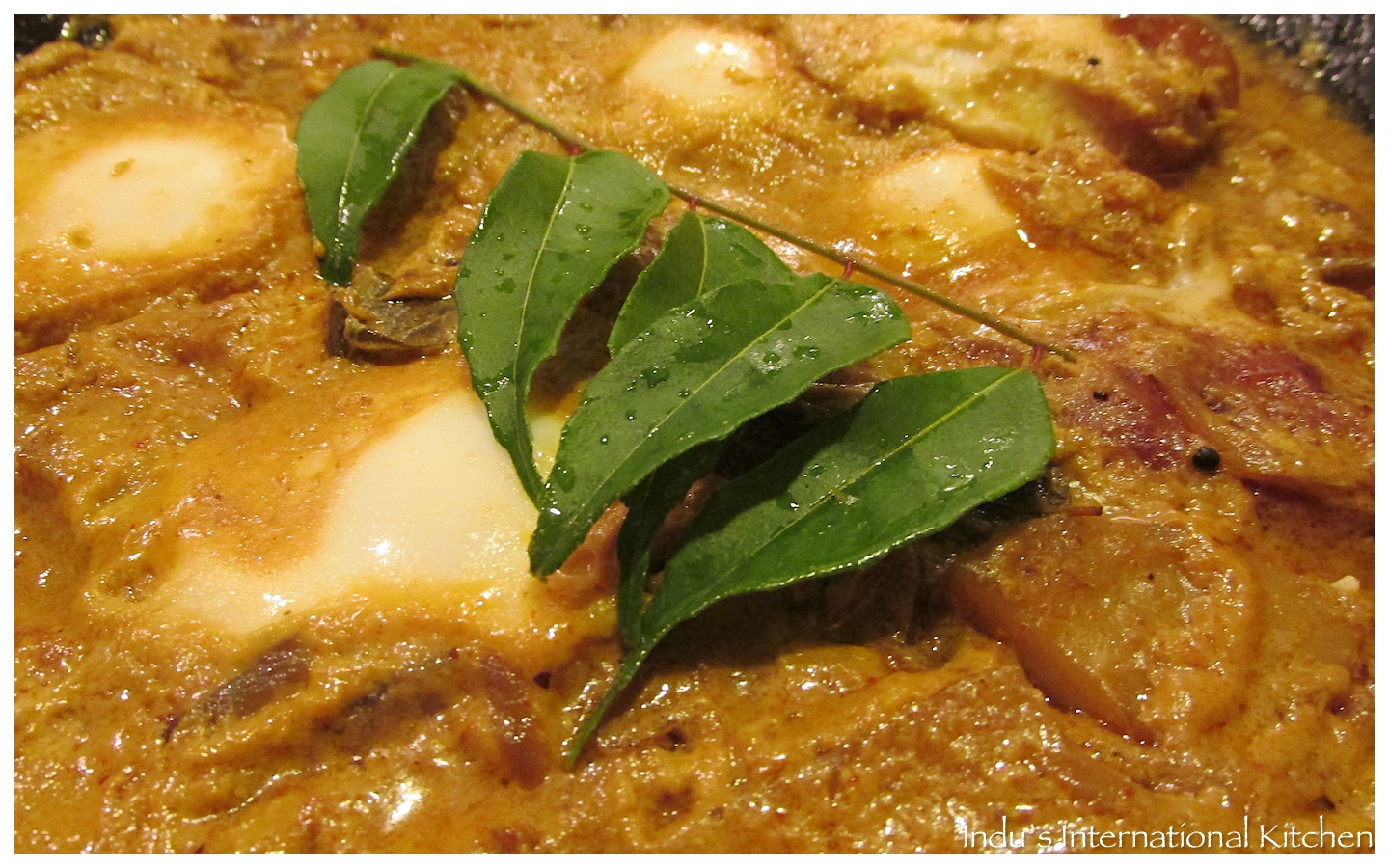 Eggs in curried coconut sauce (Kerala Style Egg curry ...